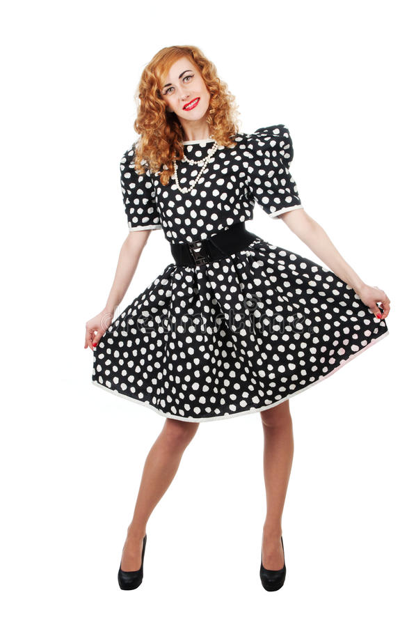 Woman in polka dot dress stock images