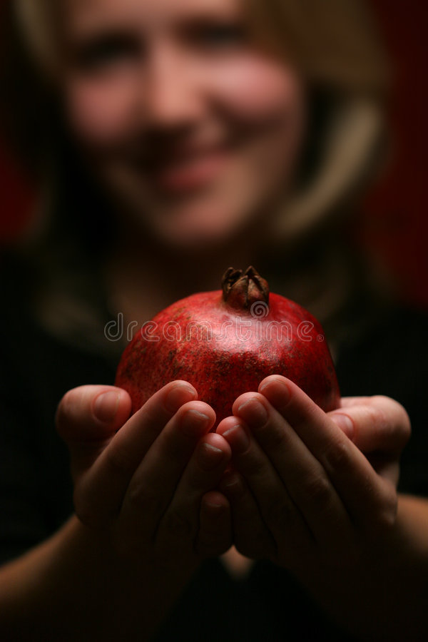 Woman and pomegranate. Red color of love stock photo