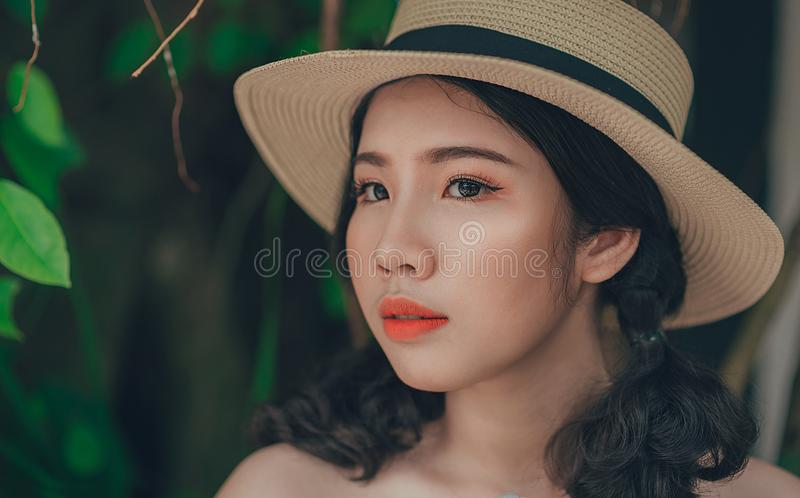 Woman With Pony-tailed Hair Wearing Brown and Blue Straw Hat royalty free stock photos