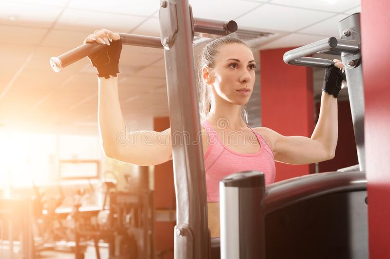 Woman doing exercises at the fitness station stock images