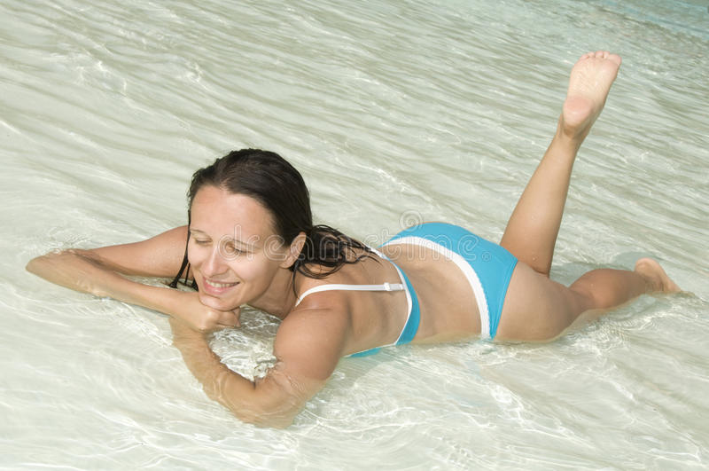 Woman at the pool stock photography