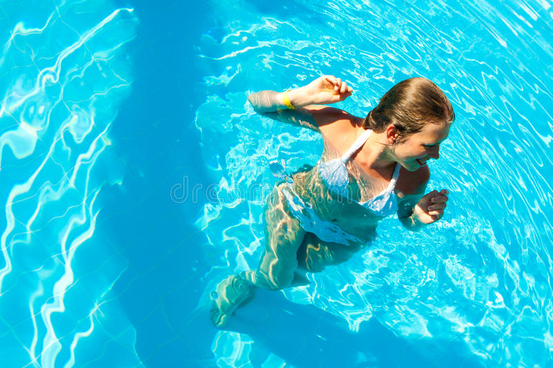 Woman in a pool royalty free stock photo