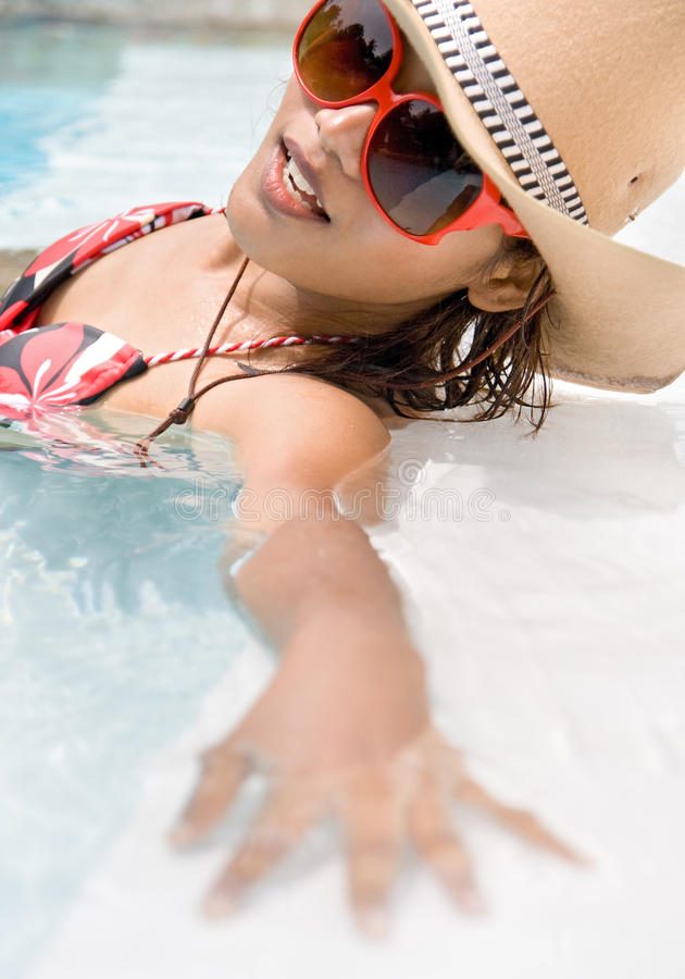 Woman in the pool stock image