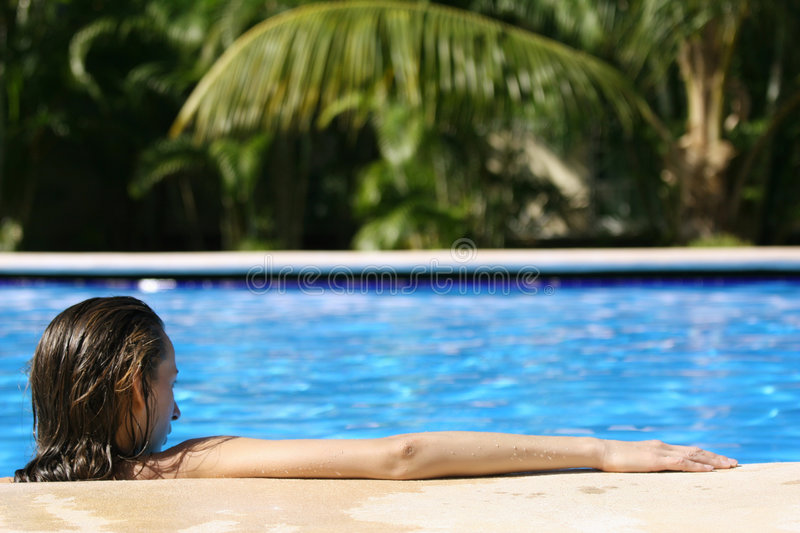 Woman in pool from behind royalty free stock photos