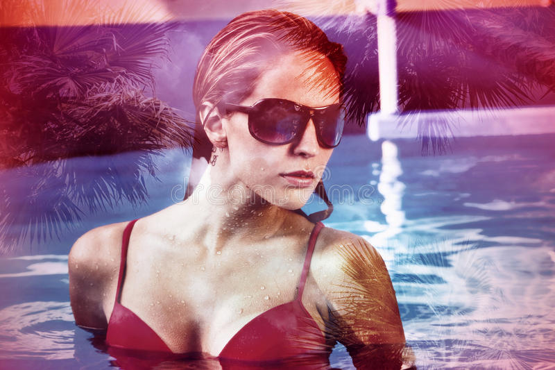 Woman in pool double exposure stock photos