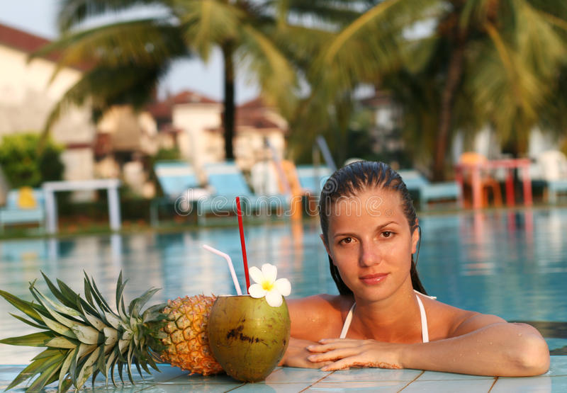Woman In Pool With Fruits Royalty Free Stock Photos