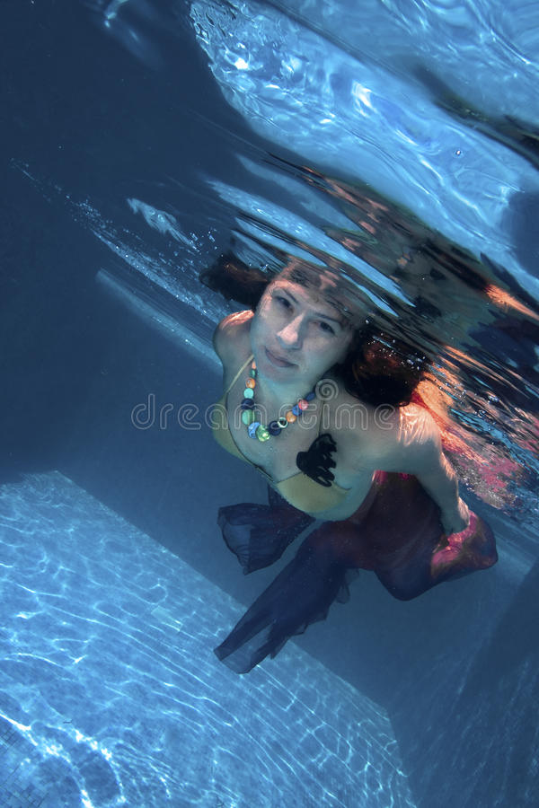 Young woman swimming underwater stock image
