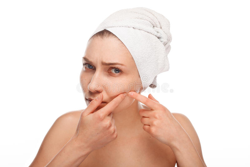 Woman popping zit royalty free stock images
