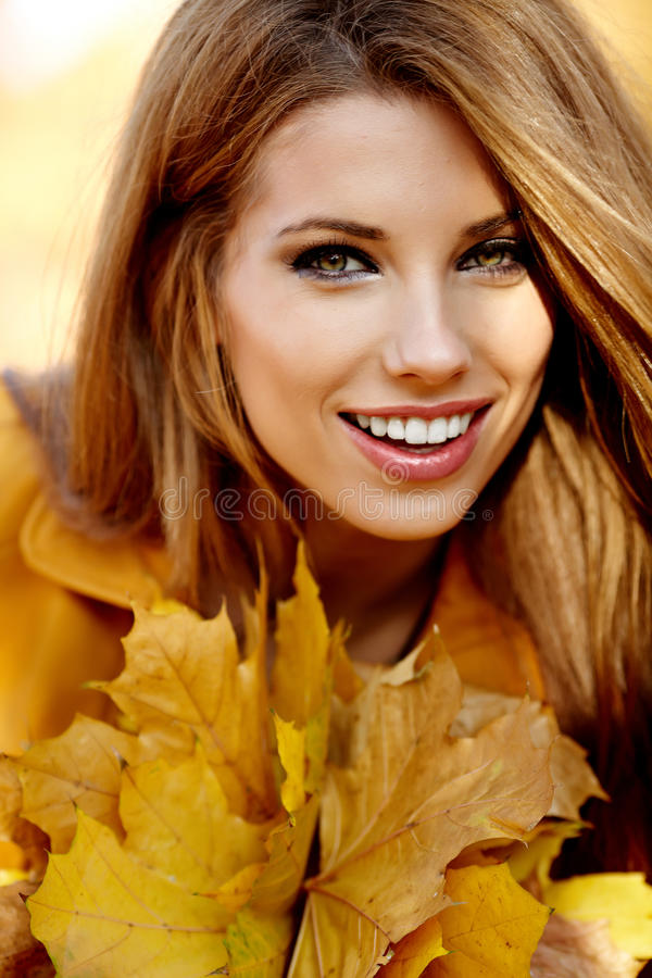 Woman portrait in autumn color royalty free stock images