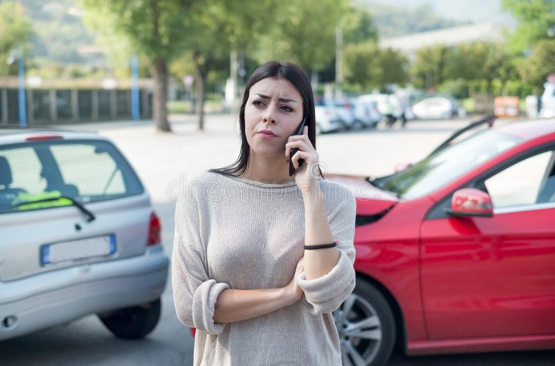 Woman calling towing service and roadside assistance royalty free stock photo