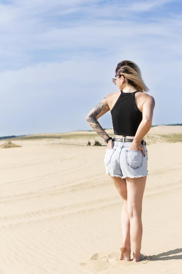 Woman portrait in the desert, rear view stock photography