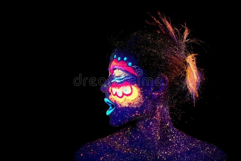 The woman portrait face, aliens asleep, ultraviolet make-up. Beautiful. woman screaming in profile stock photos