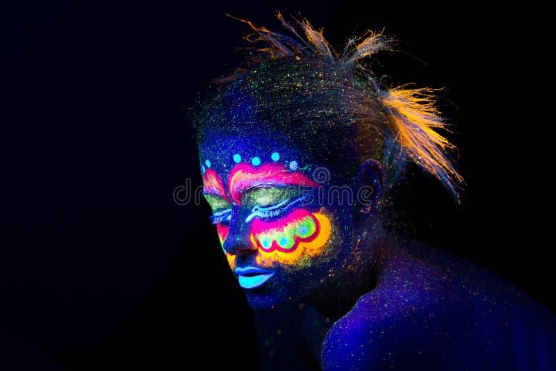 The woman portrait face, aliens portrait in semi-profile, ultraviolet make-up. stock images
