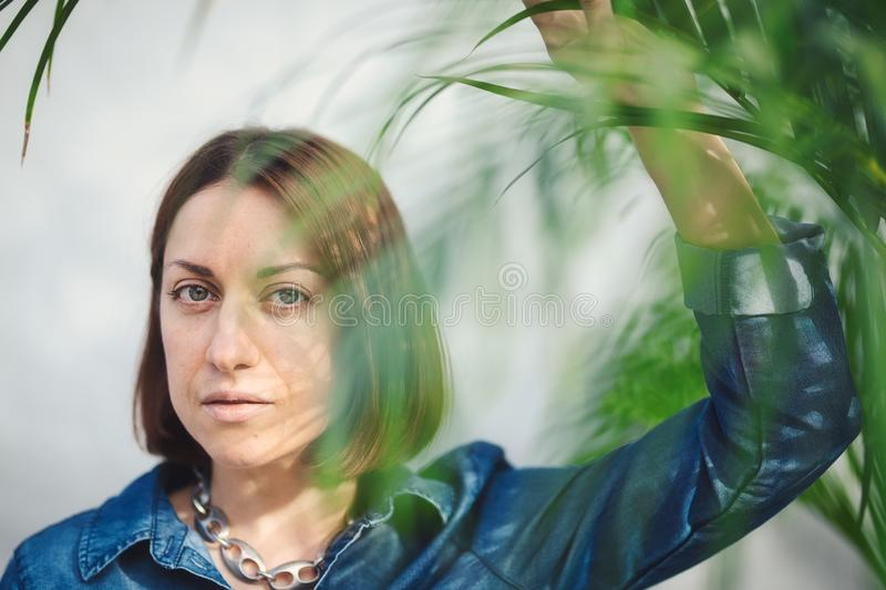 Woman portrait with green leaves royalty free stock photo