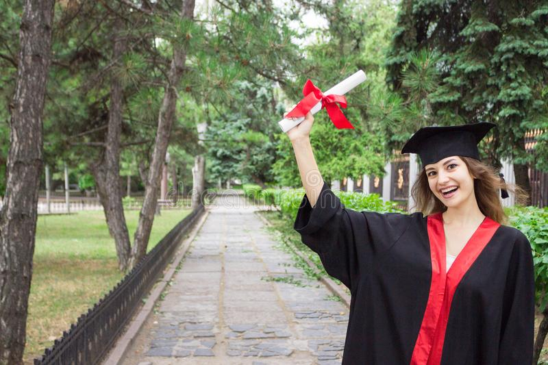 Woman portrait on her graduation day. University. Education, graduation and people concept stock image