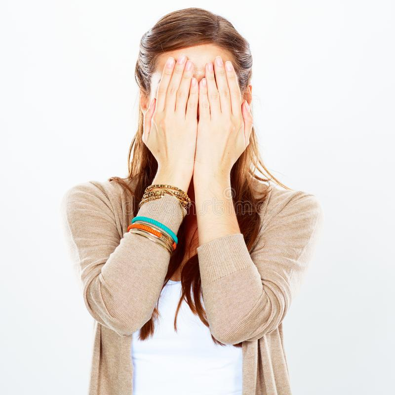 Woman portrait, hides face with hand. royalty free stock photography