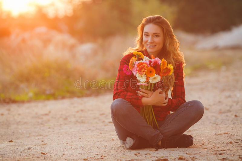 Woman portrait outdoor in sunset light. stock photography