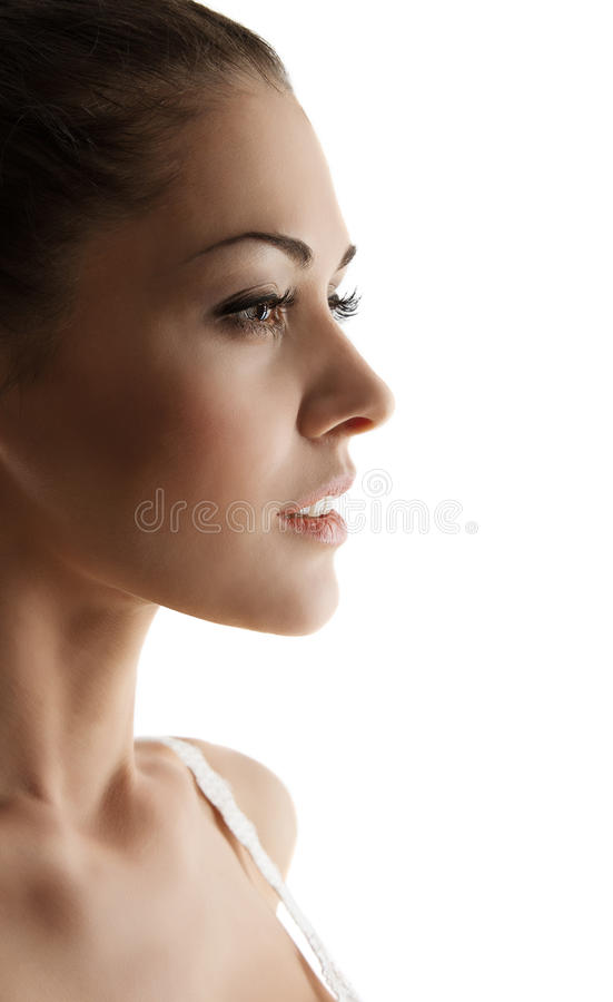 Woman portrait side view over white background. Woman side view portrait with sensual open mouth. Close up over white background stock photography