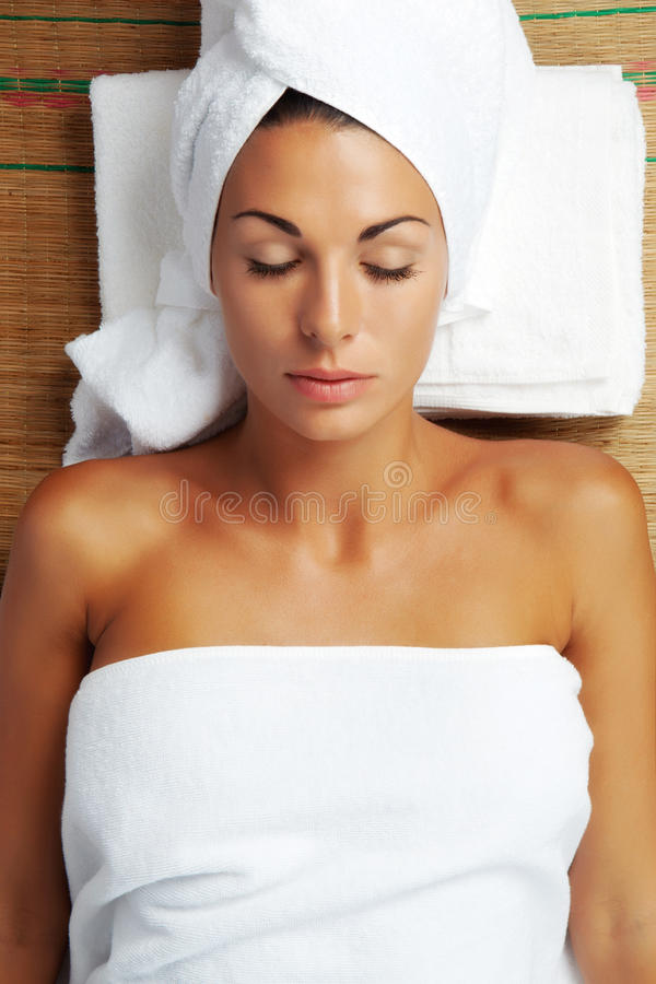 Woman. Portrait of young beautiful woman in spa environment stock photo