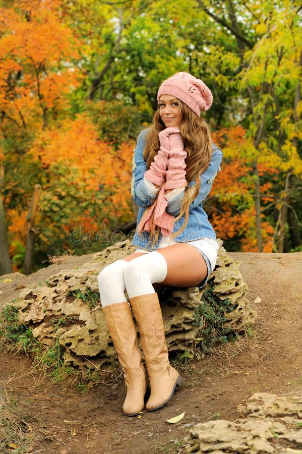 Woman posed outdoor dressed in knitted autumn outfit royalty free stock photos