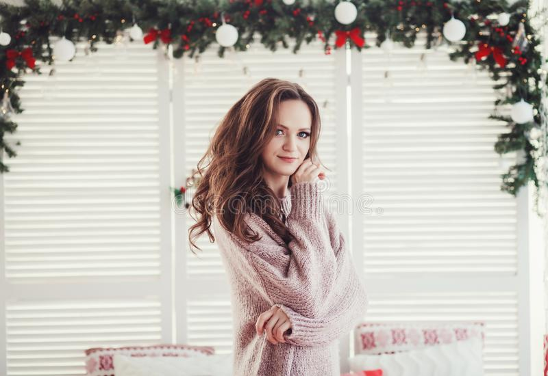 Woman posing and the background of the Christmas decor stock photos