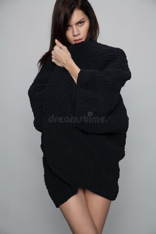 Woman posing in black long sweater royalty free stock photo