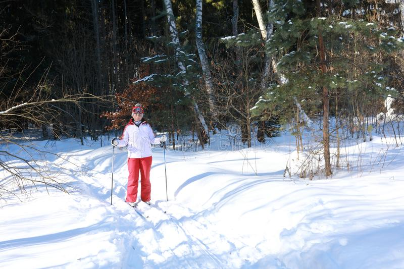 Woman posing on cross-country skiing stock photography