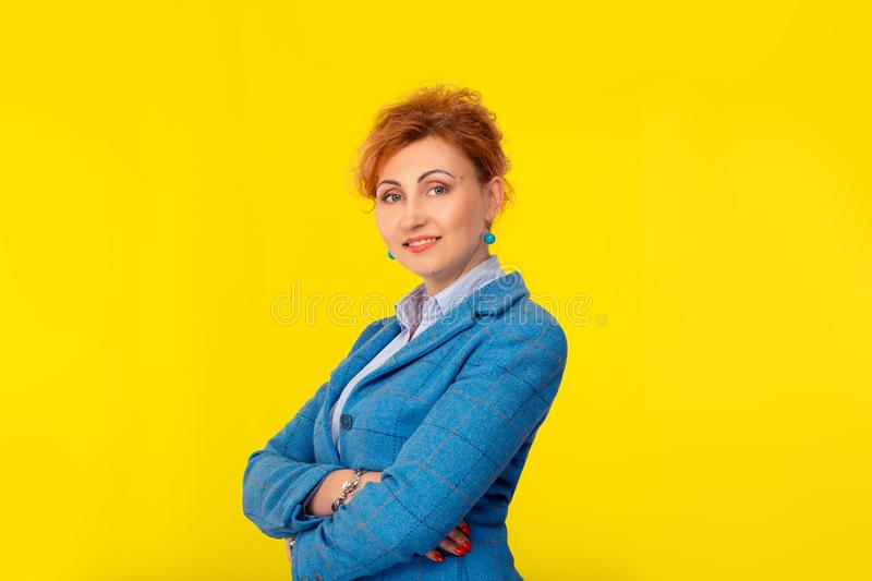 Woman posing with crossed arms confident and smiling royalty free stock photography