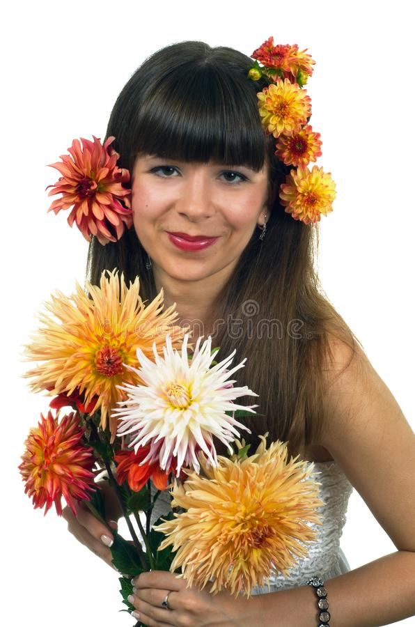 Woman posing in dahlias royalty free stock images