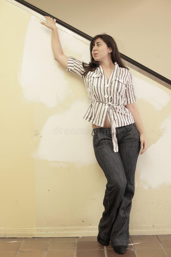 Woman Posing By An Escalator Royalty Free Stock Photos