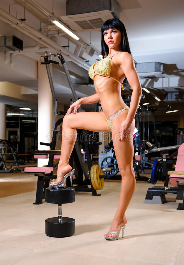Woman posing in the fitness club stock photo