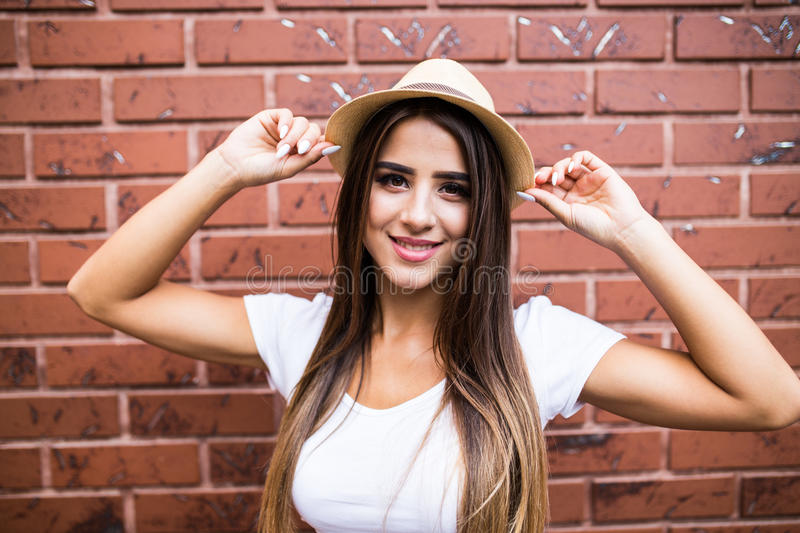 Woman posing in front of brick wall backround royalty free stock photography