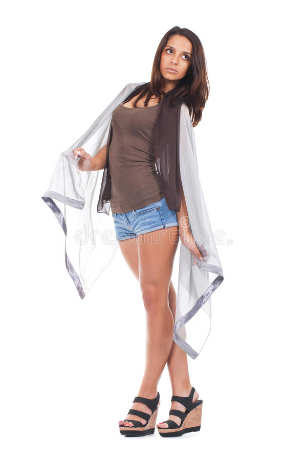 Woman posing with a grey scarf. Young and atractive woman posing wrapped in a grey scarf royalty free stock photography