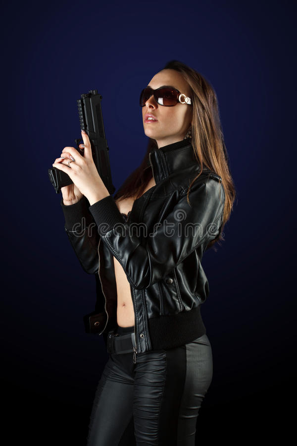 Woman posing with gun royalty free stock image