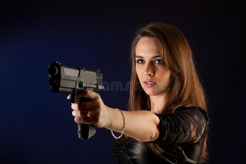 Woman posing with guns royalty free stock photography