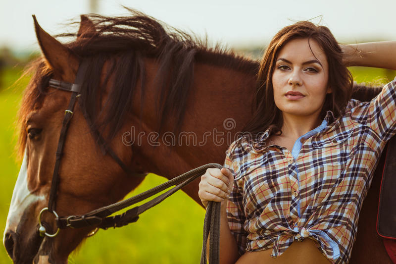 Woman posing with horse stock photography