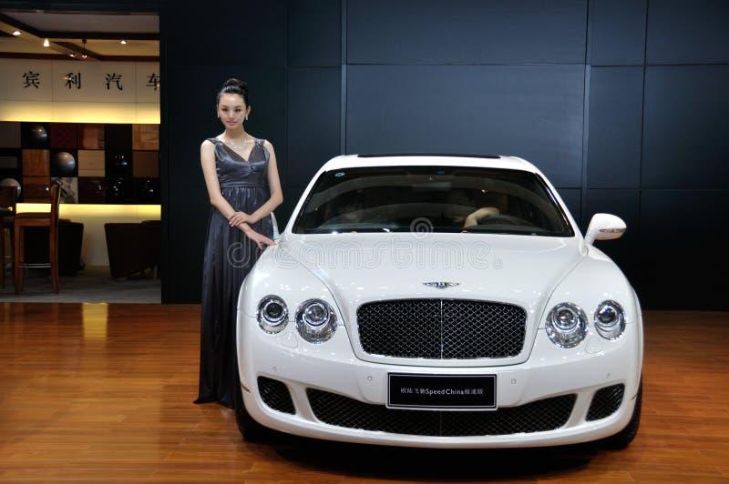 Download Woman Posing Near Car At Chengdu Motor Show 2012 Editorial Photography - Image: 26473752