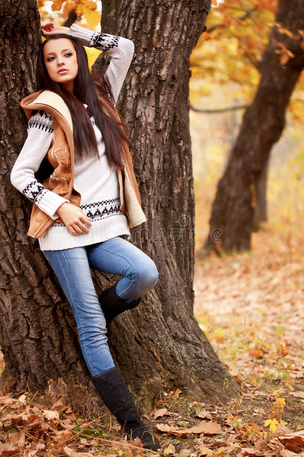 Download Woman Posing Near Tree In Autmn Park Stock Photo - Image: 21941864