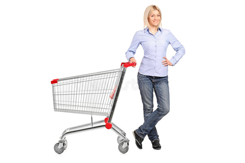 Download Woman Posing Next To An Empty Shopping Cart Stock Image - Image: 19695899