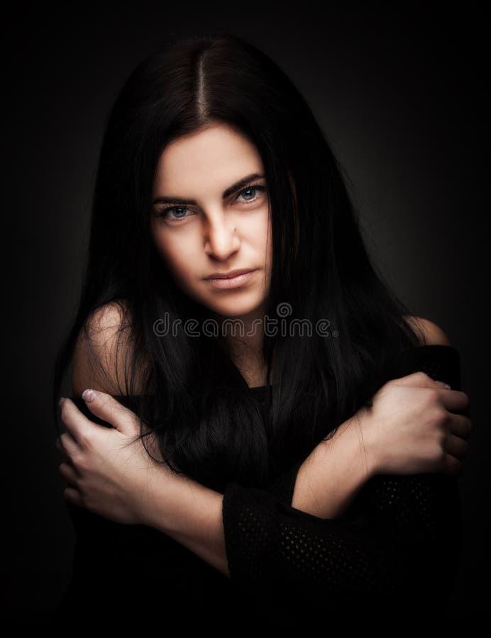 Woman Posing Over Dark Background Stock Image