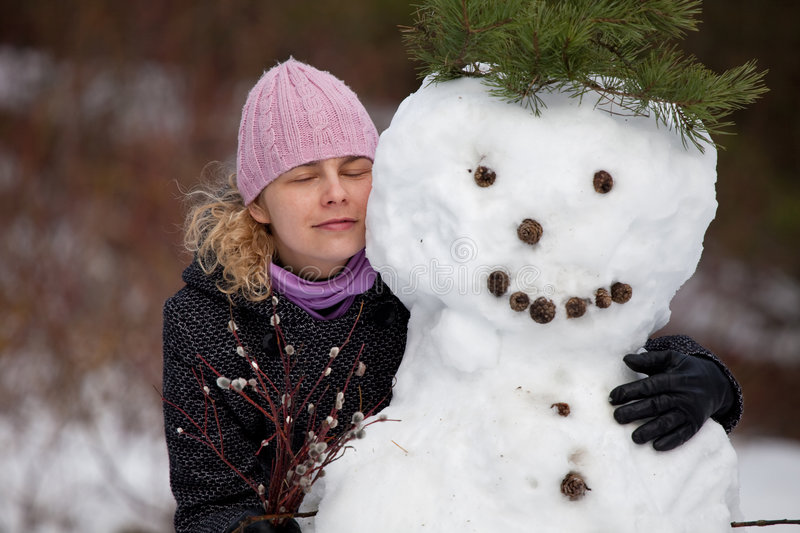 Woman posing with snowman royalty free stock photos
