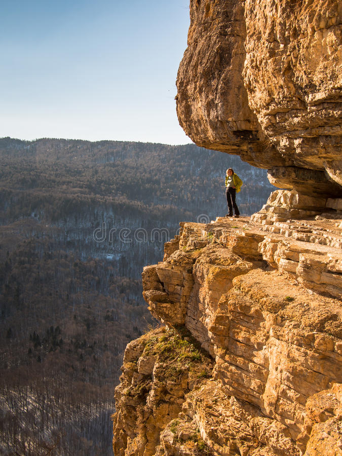 Woman posing standing on a rock royalty free stock photo