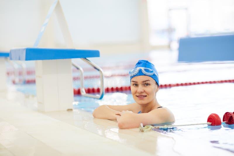 Woman Posing in Swimming Pool royalty free stock photo