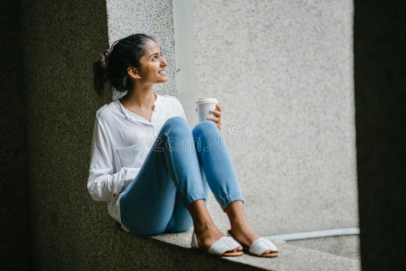 Woman posing. Wearing White Dress Shirt Sitting on Window royalty free stock image