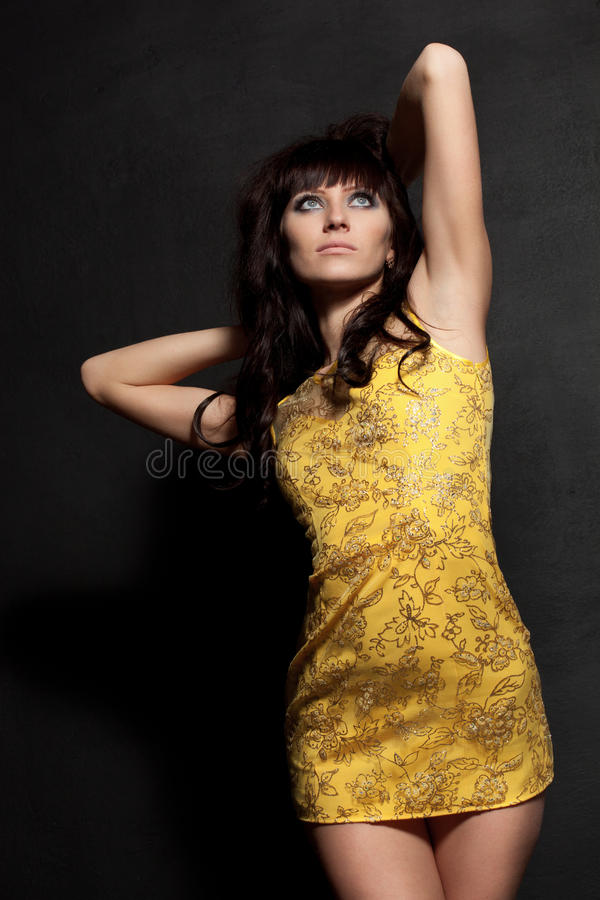 Woman posing wearing yellow dress stock photo