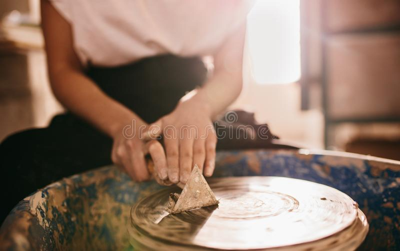 Female potter working on potters wheel royalty free stock photos