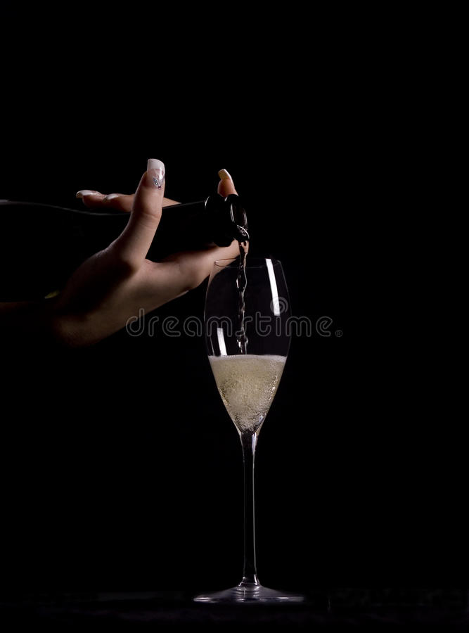 Download Woman pouring champagne stock photo. Image of celebrating - 12583076