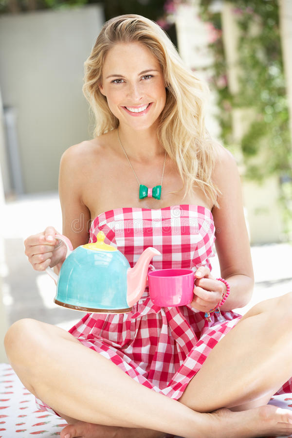 Download Woman Pouring Cup Of Tea stock photo. Image of teapot - 27273684