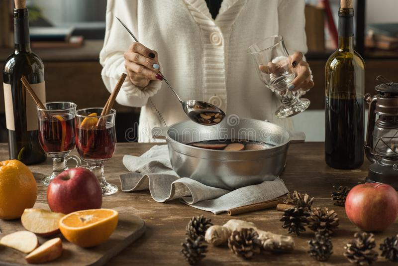 Woman pouring homemade mulled wine royalty free stock photography