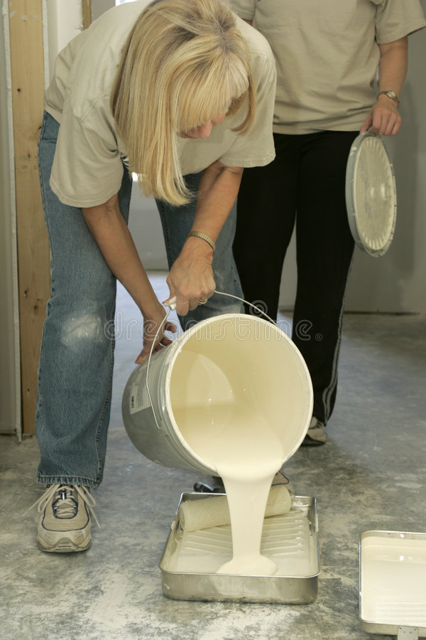Woman Pouring Paint royalty free stock image
